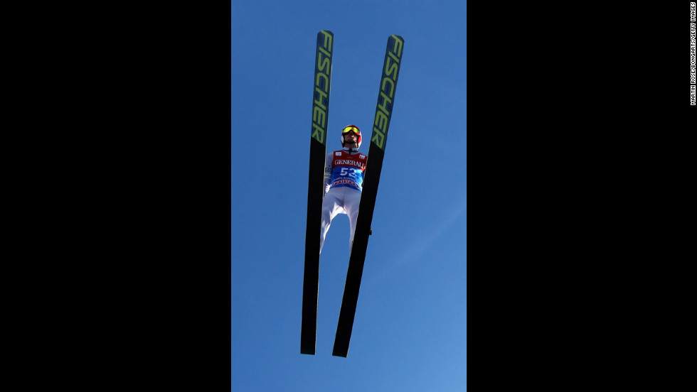 Kamil Stoch of Poland flies through a blue sky on Monday, December 31, in Garmisch-Partenkirchen, Germany.