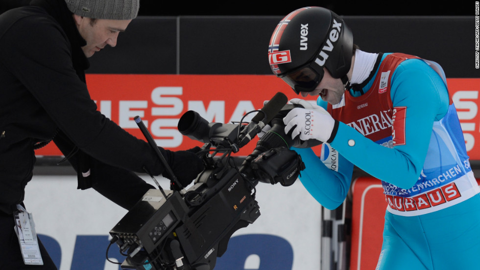 Norway's Anders Jacobsen clowns around with a TV cameraman after winning the second stage of the tournament on January 1.