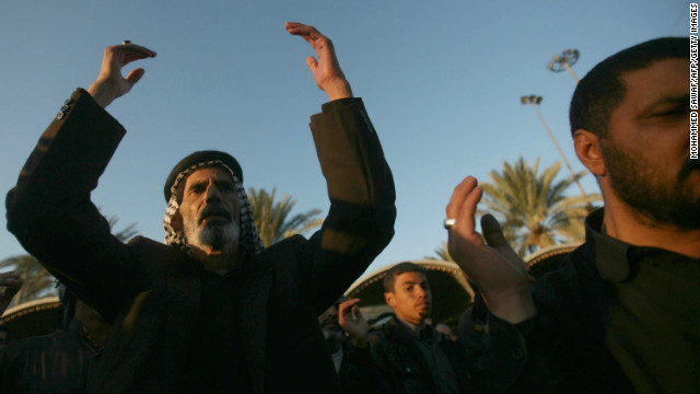 Shiite Muslim pilgrims take part in the Arbaeen rituals in the shrine city of Karbala, Iraq on January 2, 2013.