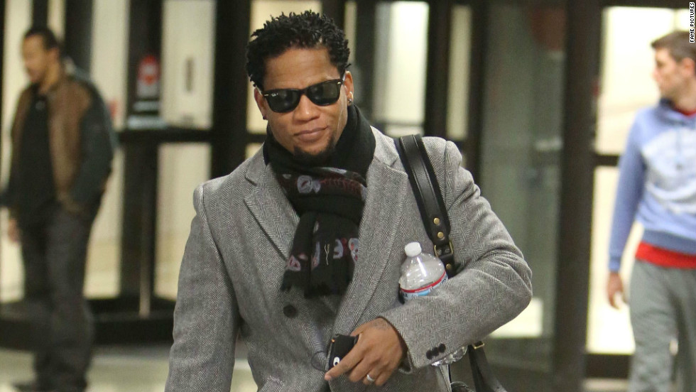 Actor and comedian D.L. Hughley walks through L.A.X. airport.