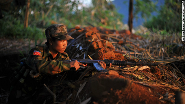 (File) A soldier from All Burma Students Democratic Front - Northern Burma, an ally of KIA on September 22, 2012.