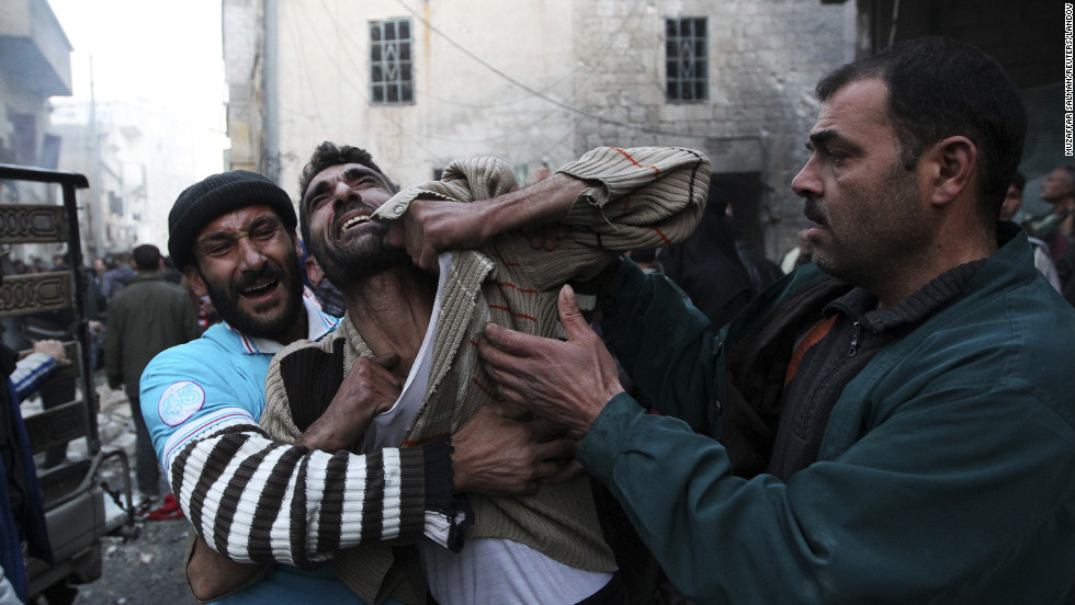 A resident reacts to the death of two of his children who activists said were killed during shelling by forces loyal to Syria's President Bashar al-Assad in the al-Ansari area of Aleppo on Thursday, January 3.