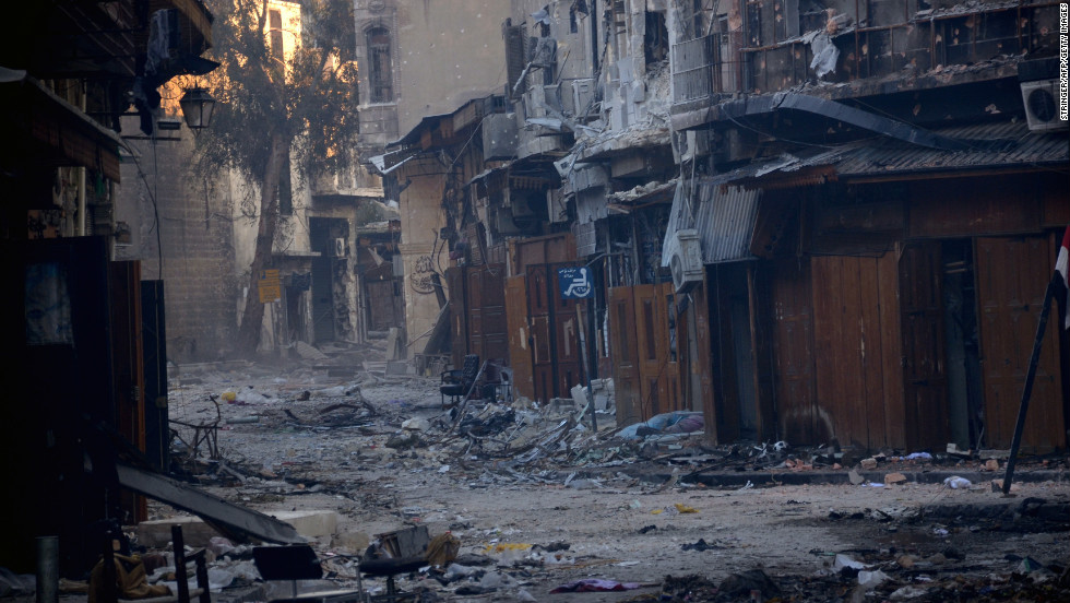 A street is filled with debris after fighting between Syrian government forces and rebels in Aleppo on January 3.