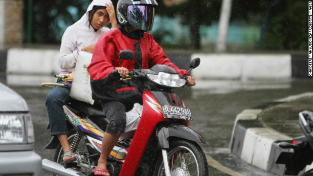 An Acehnese woman rides on the back of a motorcycle in Banda Aceh on January 2.