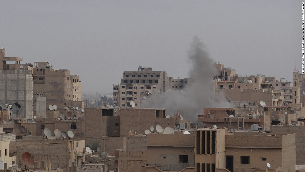 Smoke rises after what activists said was shelling by forces loyal to Syrian President Bashar al-Assad in Deir Al-Zor on Friday, January 4.