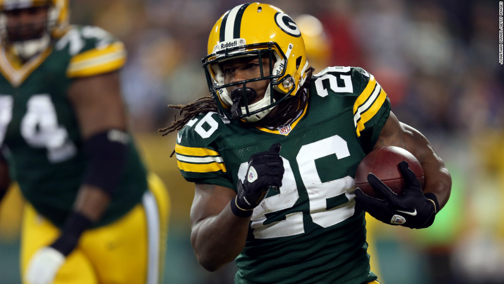 DuJuan Harris of the Green Bay Packers runs the ball in the first quarter.
