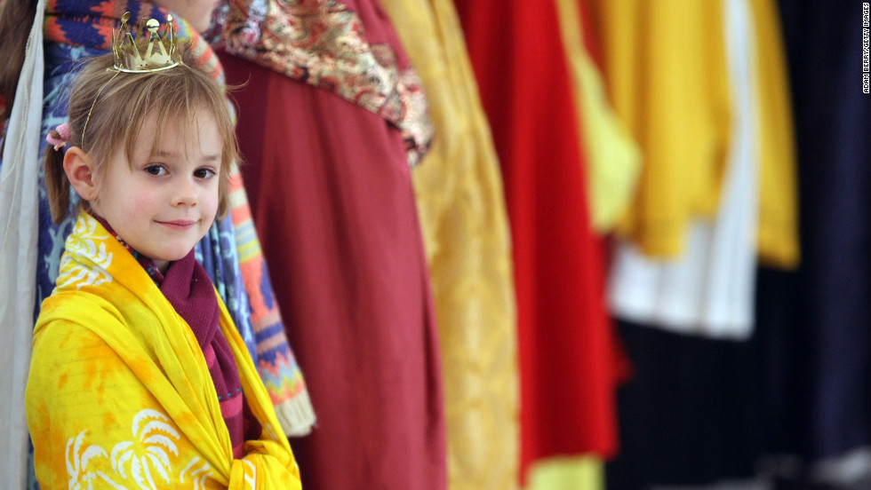 A child dressed as one of the Magi waits to greet Gauck at the Bellevue presidential palace on Sunday in Berlin.