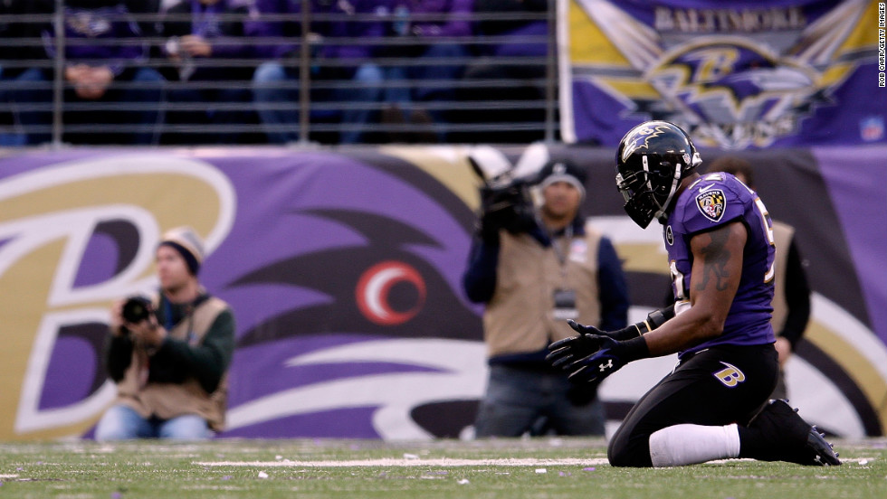 Ray Lewis of the Baltimore Ravens kneels on the field in the fourth quarter against the Indianapolis Colts on Sunday.
