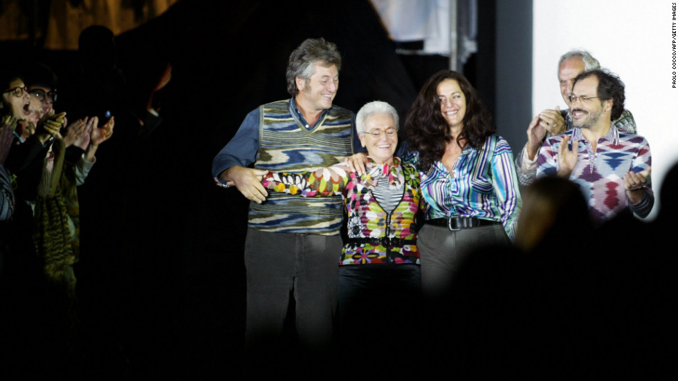 "From left: Vittorio, Rosita (his mother), Angela (his sister), Ottavio (his father) and Luca (his brother) acknowledge applause on the catwalk at the end of the Missoni collection during the last day of Milan's 2004 spring/summer fashion week on October 5, 2003. The show marked 50 years since the company was founded by Ottavio (nicknamed ""Tai "") and Rosita and 50 years since they married. Vittorio Missoni and his siblings took over the brand in 1996."