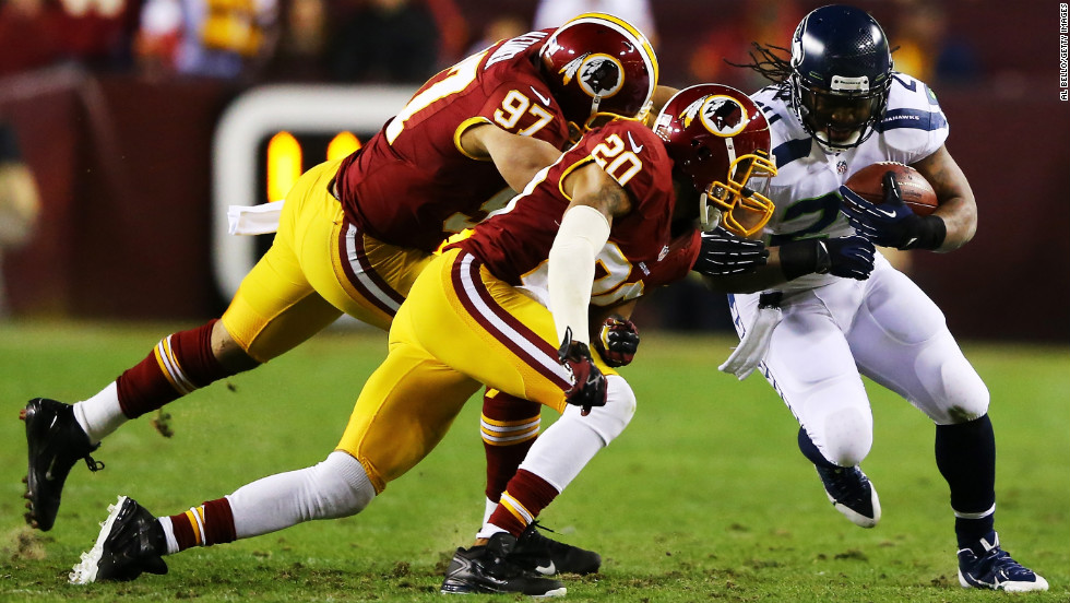 "Lorenzo Alexander, left, and Cedric Griffin, right, of the Washington Redskins tackle Marshawn Lynch of the Seattle Seahawks in the second quarter of the NFC Wild Card Playoff Game at FedEx Field on Sunday, January 6, in Landover, Maryland. Check out the action from the NFL's Wild Card weekend and then <a href=""http://www.cnn.com/2012/12/30/worldsport/gallery/nfl-week-17/index.html"" target=""_blank"">look back at the best photos from Week 17</a>."