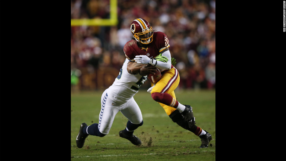 Robert Griffin III of the Washington Redskins is tackled by Leroy Hill of the Seattle Seahawks on Sunday.