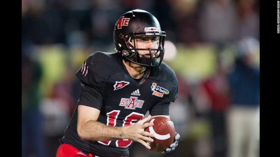 Arkansas State quarterback Ryan Aplin looks downfield for an open player during the GoDaddy.com Bowl on January 6.
