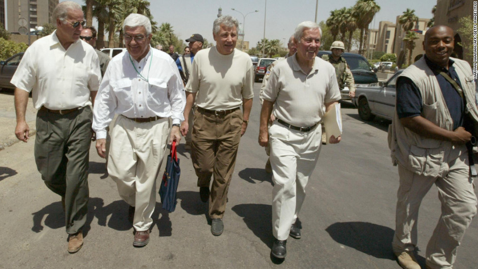 Joe Biden, left, then a U.S. senator from Delaware, walks with Sen. Richard Lugar, second from right, and Hagel, center, at a hotel in Baghdad in June 2003. The congressional delegation was on a tour of the Iraqi capital the year the Iraq War began.