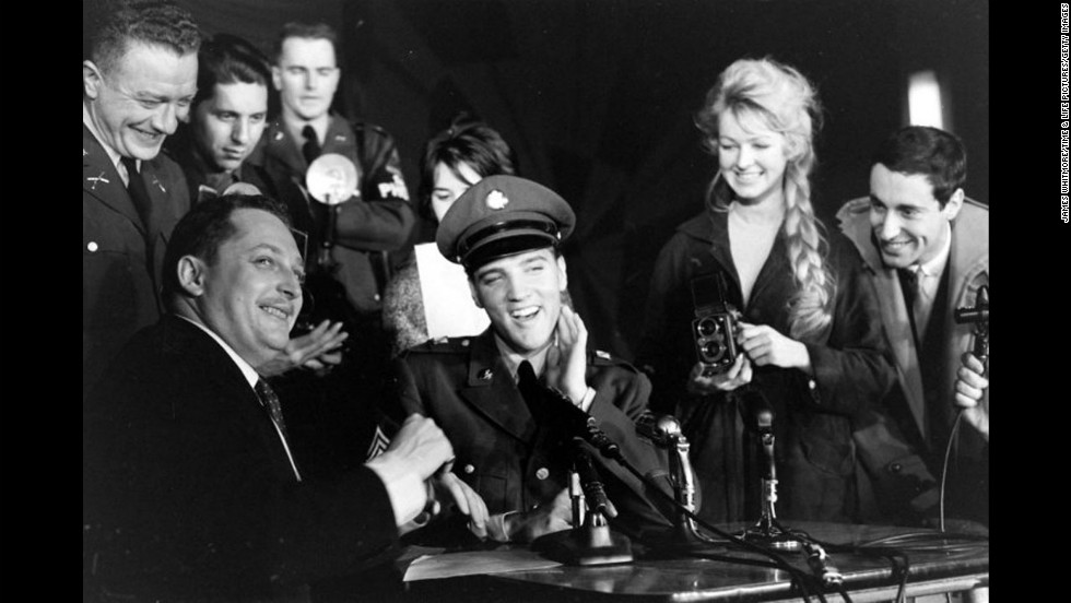 Sgt. Elvis Presley at a press conference before leaving Germany in March 1960.