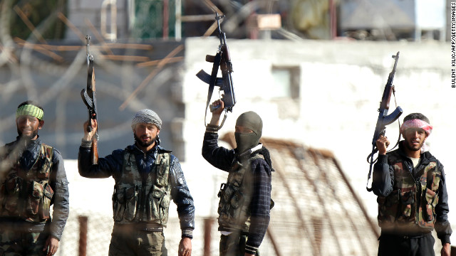 Syrian opposition fighters celebrating on the strategic Syrian border town of Ras al-Ain, on November 15, 2012.