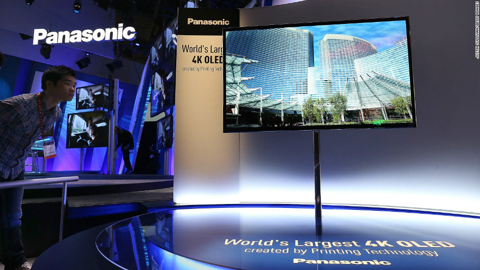 An attendee looks at a display of the Panasonic 4K OLED 56' television at the company's booth in the Las Vegas Convention Center.