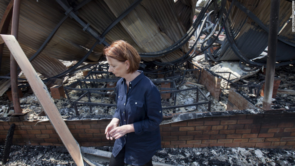 Australian Prime Minister Julia Gillard inspects the destroyed remains of the Dunalley school in southeast Tasmania, Australia, on Monday, January 7.