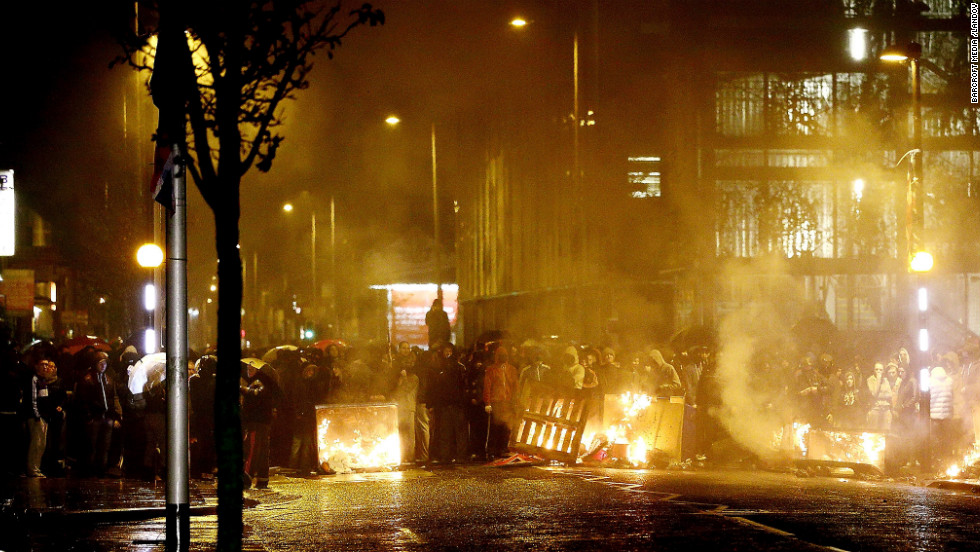 Protesters set up a burning roadblock in Belfast on Monday.