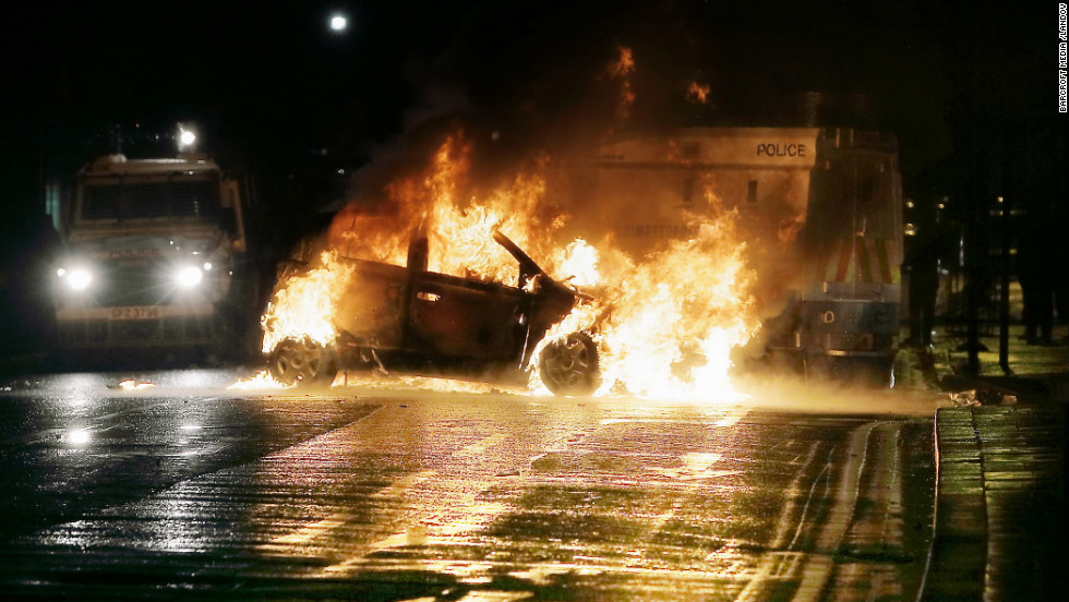 A car burns after the protests on Sunday, January 6.