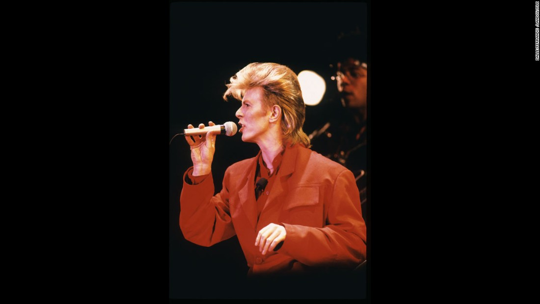 Bowie performs sporting a blond mullet in 1987.