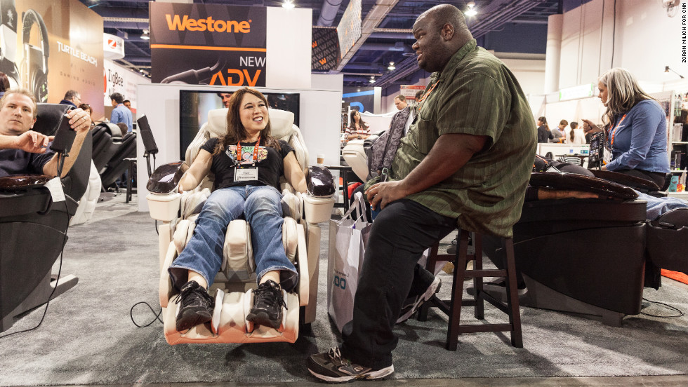 CES attendees enjoy the EP MA70 full-body heated massage chair by Panasonic. The chair sells for about $7,000.