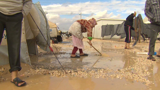 Syrian refugees live in cold, wind, rain