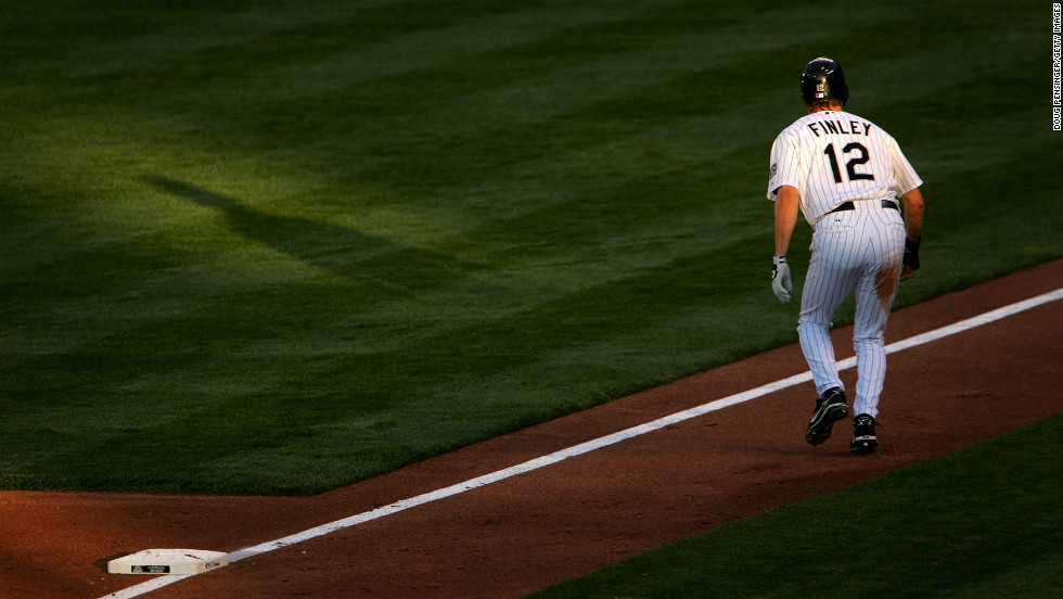 Steve Finley of the Colorado Rockies takes a lead off third base against the San Francisco Giants at Coors Field on May 10, 2007, in Denver.