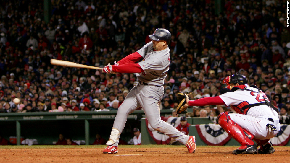 Larry Walker of the St. Louis Cardinals hits an RBI double in the sixth inning against the Boston Red Sox during Game One of the 2004 World Series on October 23, 2004, at Fenway Park in Boston.
