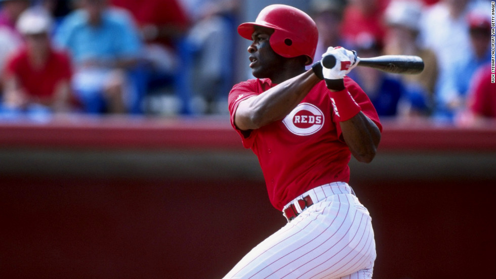Outfielder Reggie Sanders of the Cincinnati Reds takes a turn at bat during a spring training game against the Philadelphia Phillies in Sarasota, Florida, on March 7, 1998.