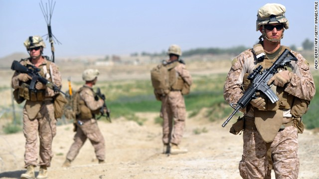 U.S. Marines from the 3rd Battalion 8th Marines Regiment start their patrol in Helmand Province on June 27.