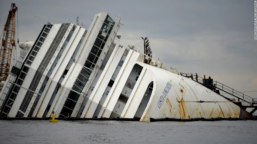 The Costa Concordia cruise ship lies aground near the port on Wednesday, January 9.