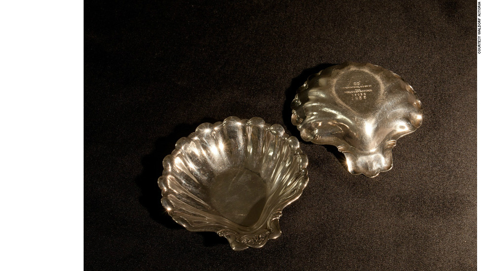 These shell-shaped nut dishes were used at the Waldorf's Peacock Alley bar in the late 1950's, providing snacks to late-night guests. The donor's father is thought to have spirited the stylish utensils away with him after a brief stay in the hotel during this period.