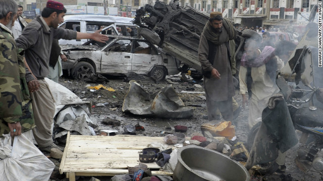 Debris and mangled vehicles are seen at the site of a bomb explosion in Quetta on January 10, 2013.