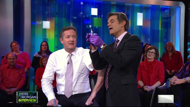 pmt dr mehmet oz piers gets a flu shot_00003502.jpg