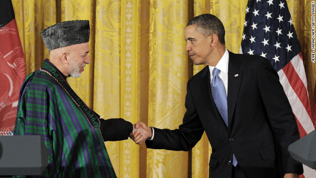 U.S. President Barack Obama and Afghan President Hamid Karzai shake hands after Friday's joint news conference.
