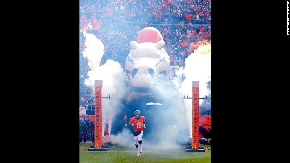 Denver quarterback Peyton Manning takes the field during player introductions on Saturday.