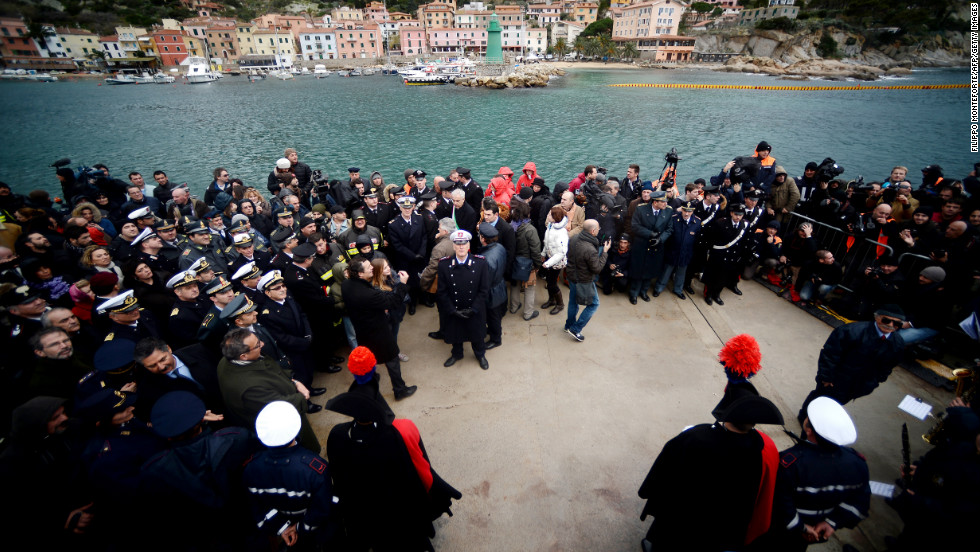 A commemorative board with the names of the victims is unveiled in Giglio on Sunday.