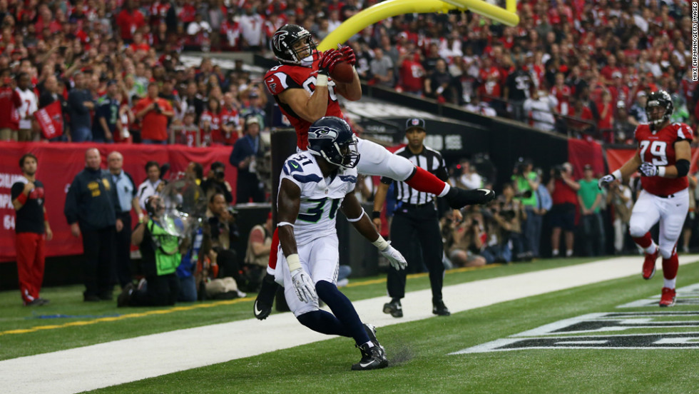 Falcons tight end Tony Gonzalez catches a first-quarter touchdown pass over Kam Chancellor of the Seahawks on Sunday.