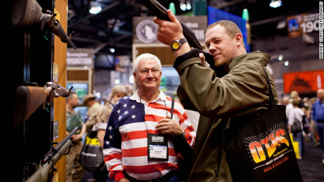 Pat Darling (L) and his nephew, Chip Darling, look at a Remington rifle display during the NRA Annual Meetings and Exhibits April 14, 2012 at America's Center in St. Louis, Missouri. More than 60,000 people are expected to attend the convention, which runs through Sunday. (Photo by Whitney Curtis/Getty Images)