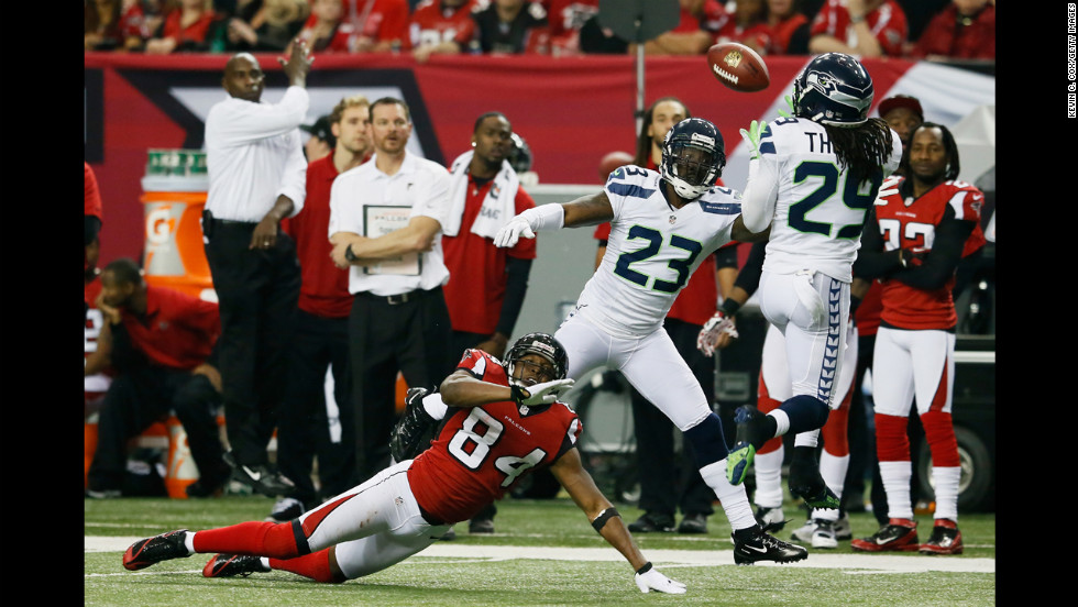 Earl Thomas of the Seahawks intercepts a pass intended for Roddy White of the Falcons in the fourth quarter on Sunday.