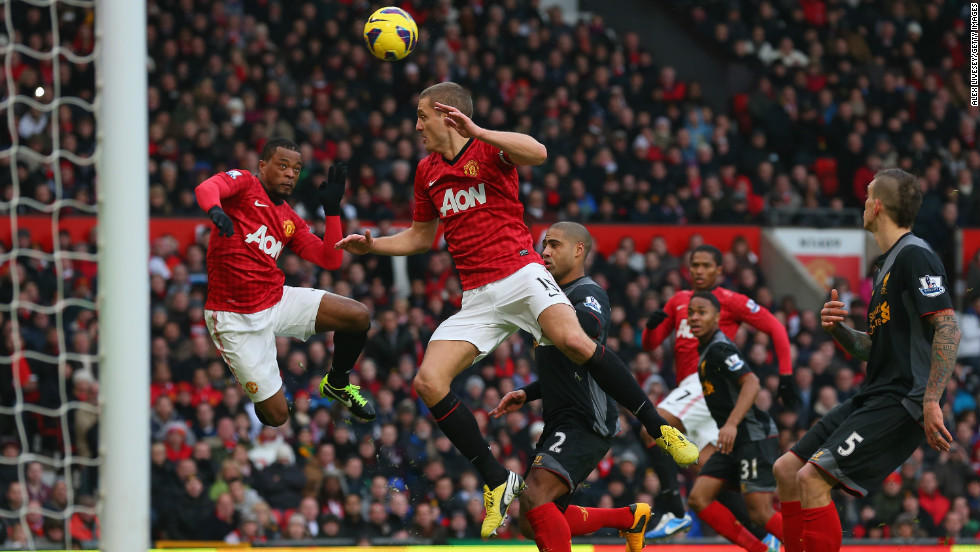Nemanja Vidic was credited with Manchester United's winning goal against Liverpool after he inadvertently deflected a header by teammate Patrice Evra, left, past goalkeeper Pepe Reina.