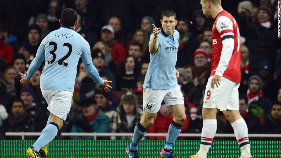 However, James Milner scored soon after and Dzeko doubled the lead before halftime -- with Carlos Tevez, left, involved in both goals.