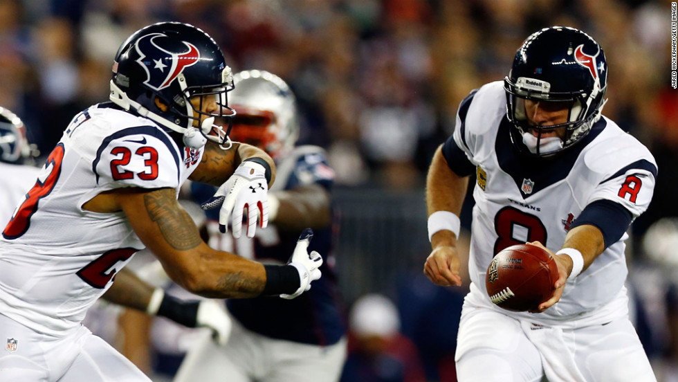 Matt Schaub of the Houston Texans hands the ball off to Arian Foster.