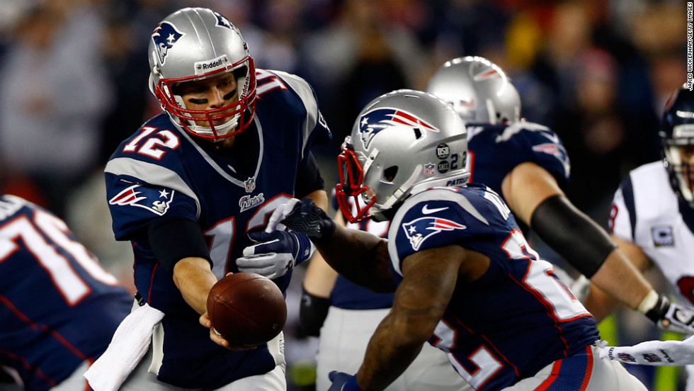 Tom Brady of the Patriots hands the ball off to Stevan Ridley on Sunday.