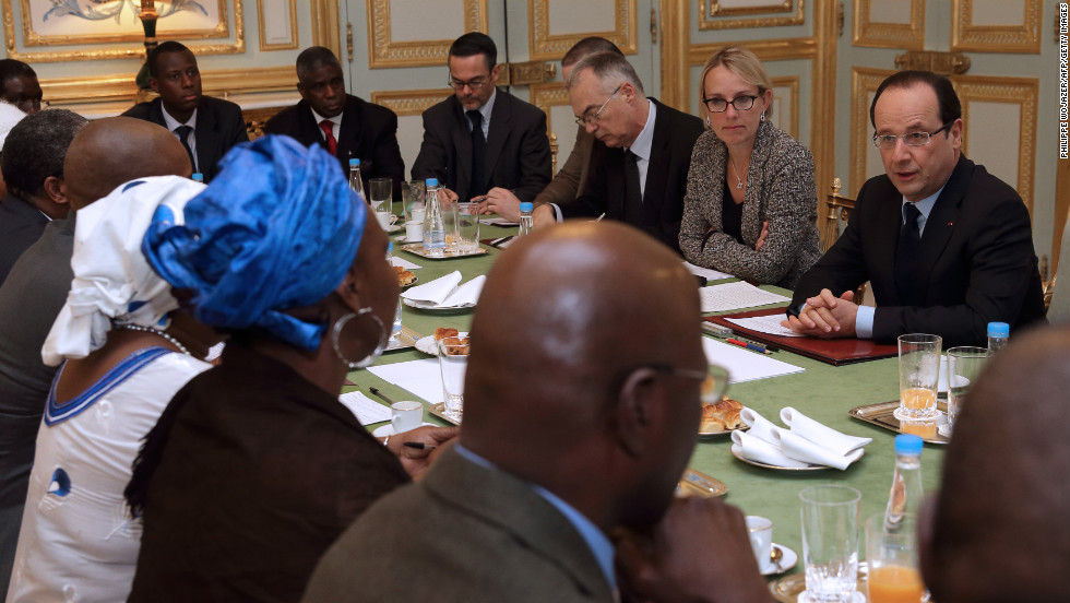 French President Francois Hollande, right, speaks with members of Malian associations in France during a meeting at the Elysee Palace in Paris on Sunday.