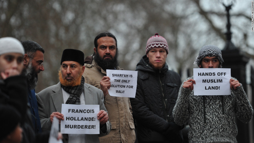 Muslim men protest French military action in Mali outside the French Embassy in central London on Saturday, January 12. About 50 Muslim protesters gathered outside the embassy.