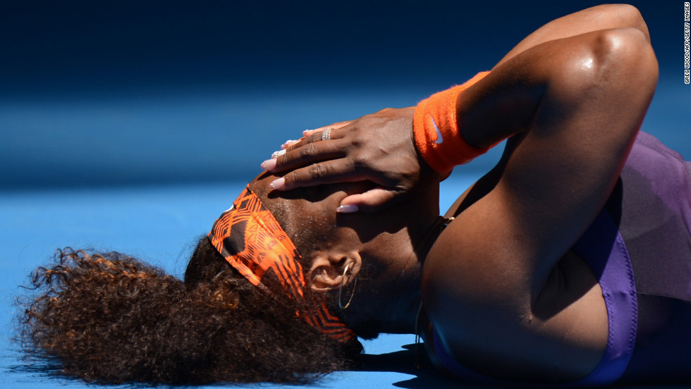 Serena Williams of the United States falls to the court during her first-round match against Romania's Edina Gallovits-Hall on January 15.