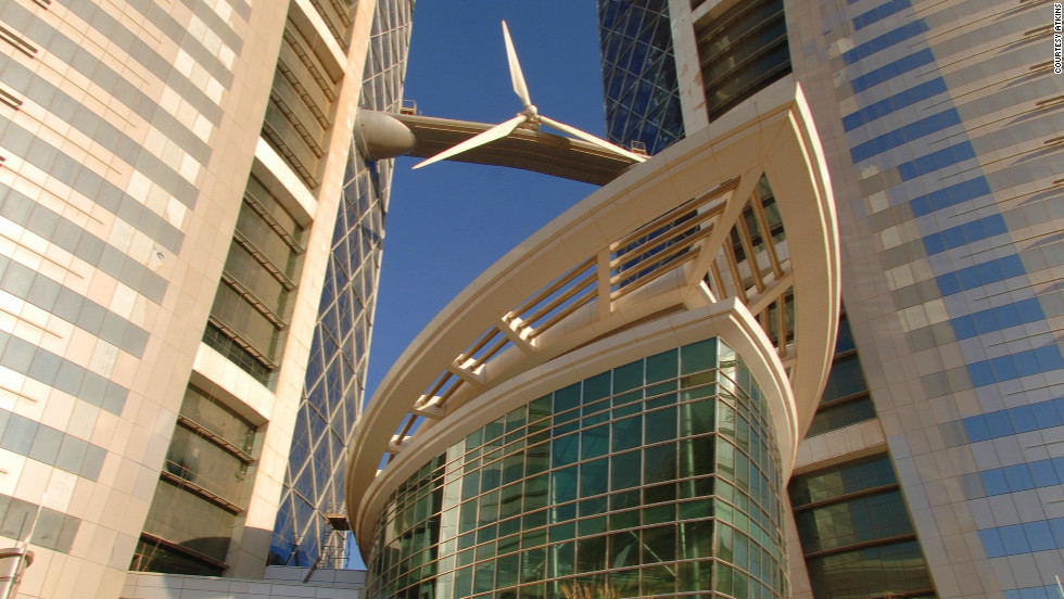 "<a href=""http://www.bahrainwtc.com/"" target=""_blank"">The Bahrain World Trade Center</a>, built in 2008, is 50 floors high, and,  uniquely, giant wind tubines connect the building's two towers. The turbines generate for 11-15% of the power required by the building when fully operational, according to architect <a href=""http://www.atkinsglobal.com/"" target=""_blank"">Atkins</a>."