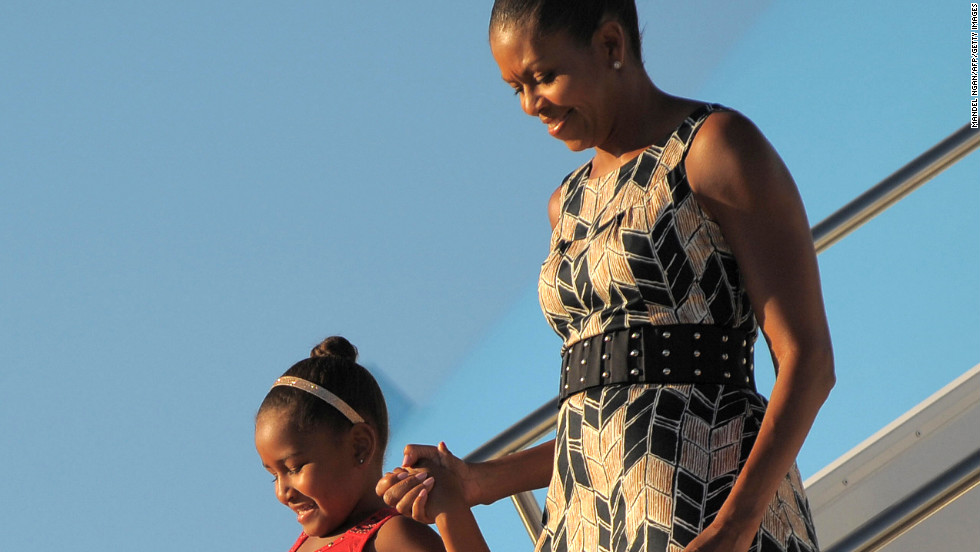 "Obama has worn <a href=""http://mrs-o.com/newdata/2009/8/17/scenes-from-the-weekend-updated.html"" target=""_blank"">this Target dress</a> on multiple occasions since being photographed in it as she stepped off Air Force One with daughter Sasha on August 15, 2009, according to the Mrs. O blog."