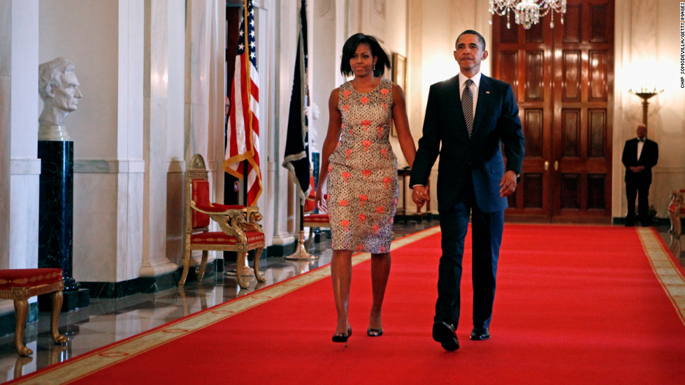The first lady made an entrance at the 2011 Medal of Honor ceremony in a brocade dress by Barbara Tfank that she has worn on multiple occasions since, Taylor said.